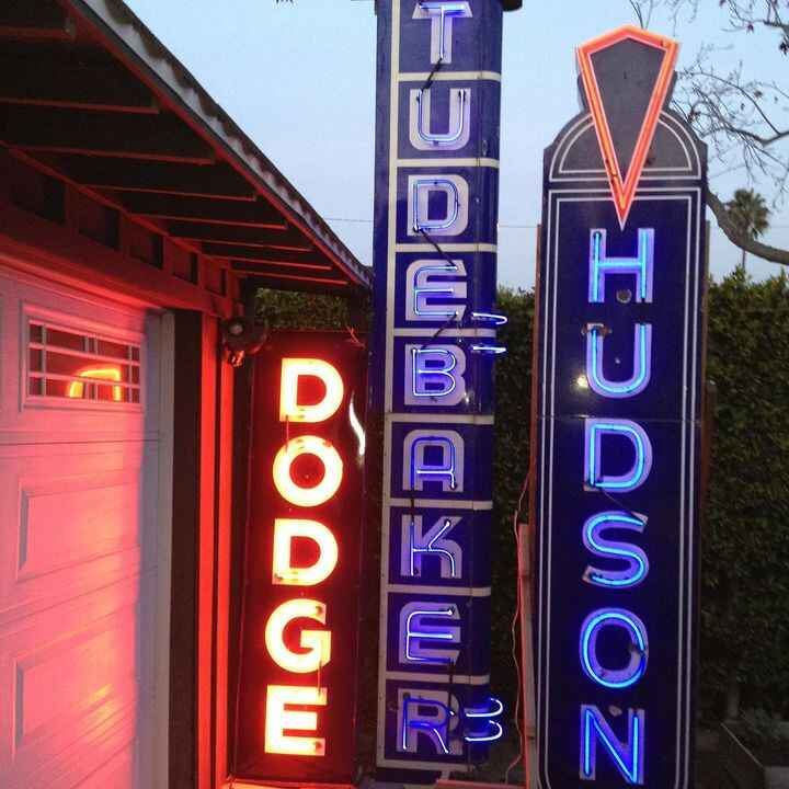 Out of my personal collection these fabulous porcelain neon dealership signs.  Studebaker 1930s double sided (neon for o...