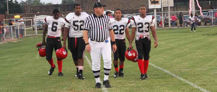 HERE COME THE BULLDOGS... Okmulgee High School's football captains head onto the field Friday for the coin toss at Okema...
