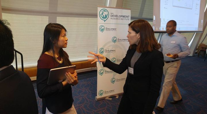 Laura Alfaro speaking to particants at the 2015NYU DEVELOPMENT Research institute event in NY