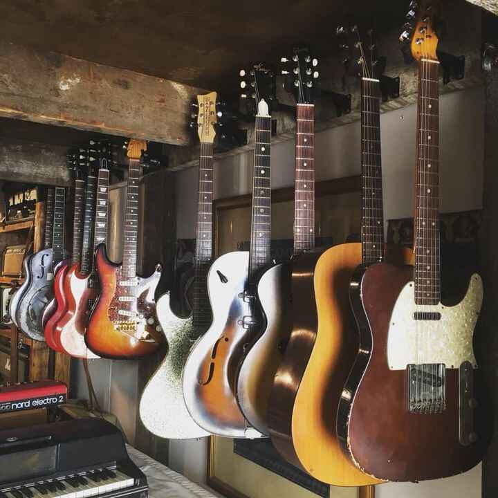 Some guitars and a guitarist (John Fuentes) recently at the shop!